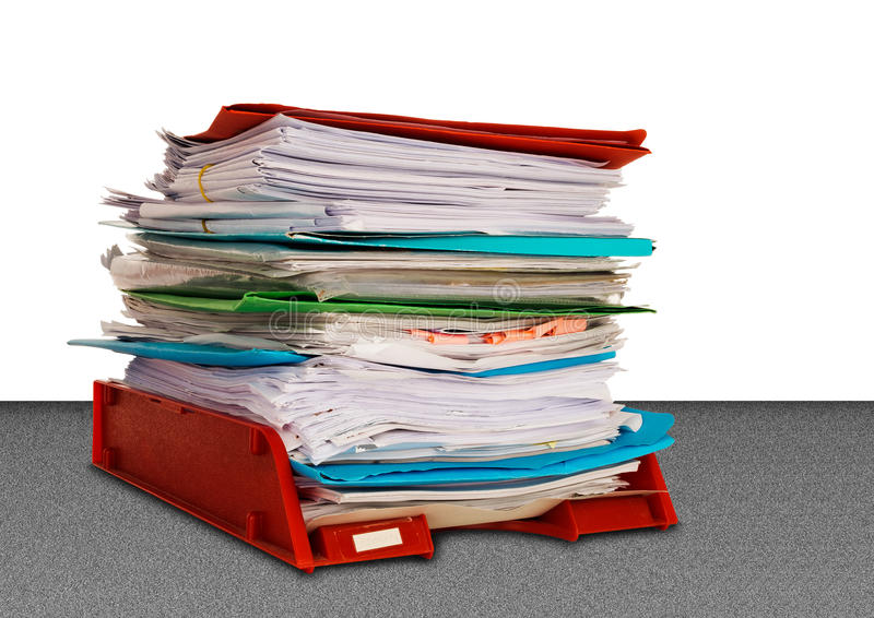 Office administration in-tray aka in tray isolated over white. Overwork or bureaucracy with lots of paperwork royalty free stock photo