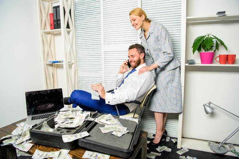 Office assistant gives massage boss help relax. Businessman rich bearded guy sit office with lot of cash money. Man. Successful businessman phone conversation royalty free stock image