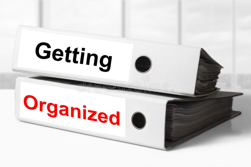 Office binders getting organized. Two white office binders getting organized stock image