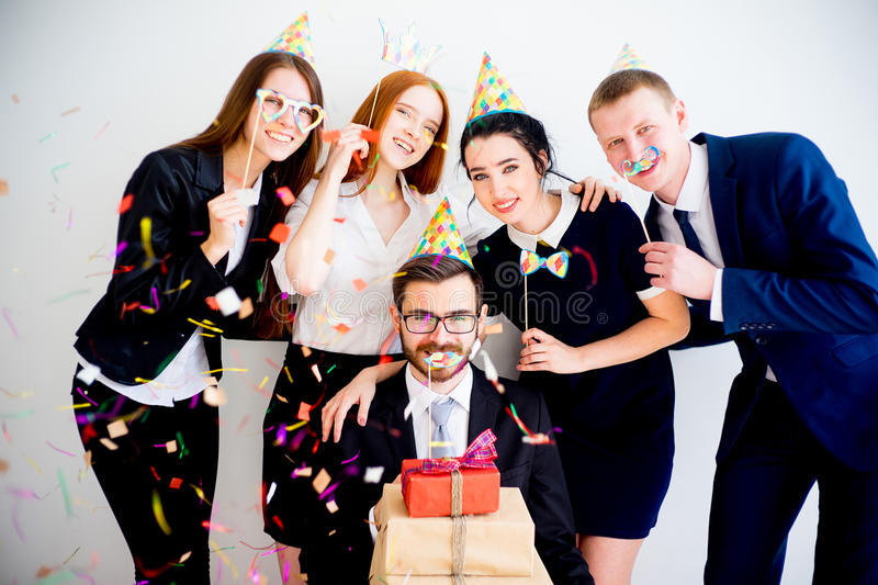 Office birthday party. Celebrating a colleague`s birthday in the office royalty free stock image