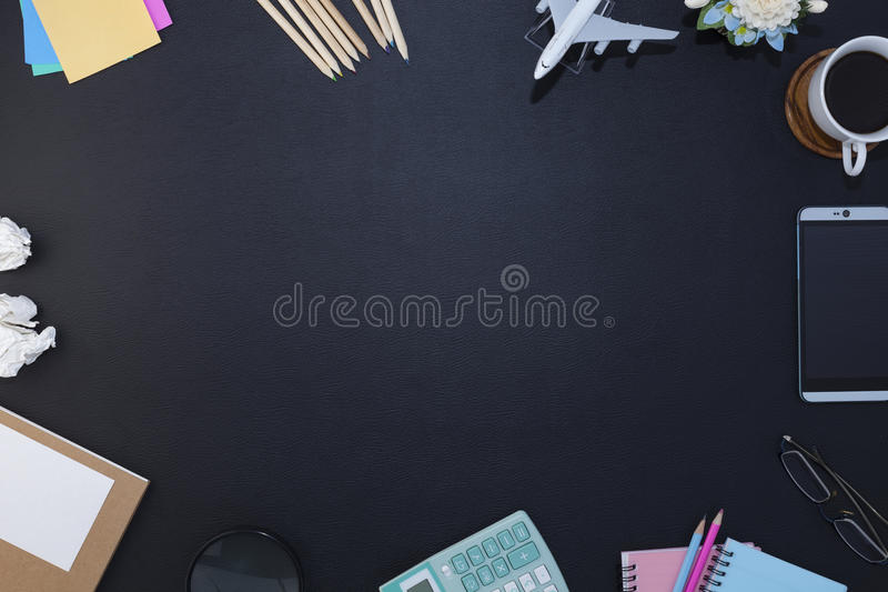 Office black leather desk table with notebook, supplies and coffee cup ,office accessory, Top view with copy space. stock image