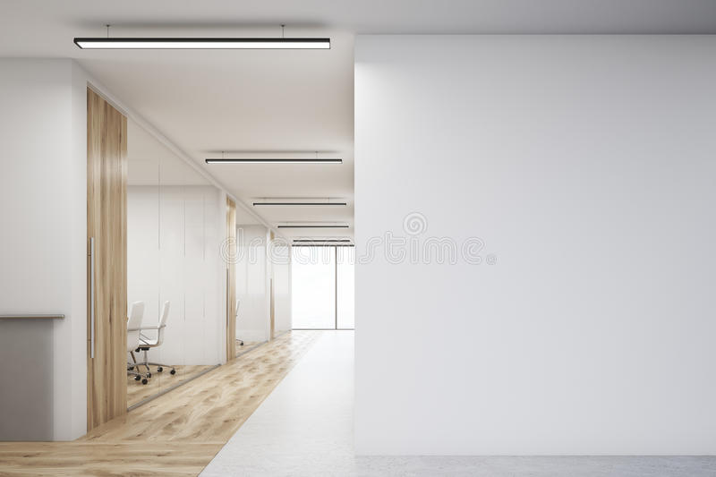Office with blank wall and row of meeting rooms. Office corridor with large blank wall and row of conference rooms with wooden wall and floor decoration. 3d stock illustration