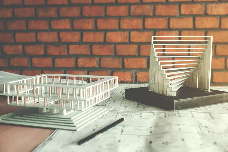 Office on blueprint And model building. Architects workplace stock image