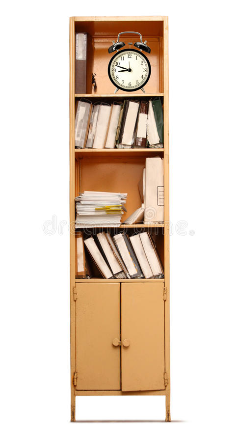 Office bookcase and alarm clock stock photography
