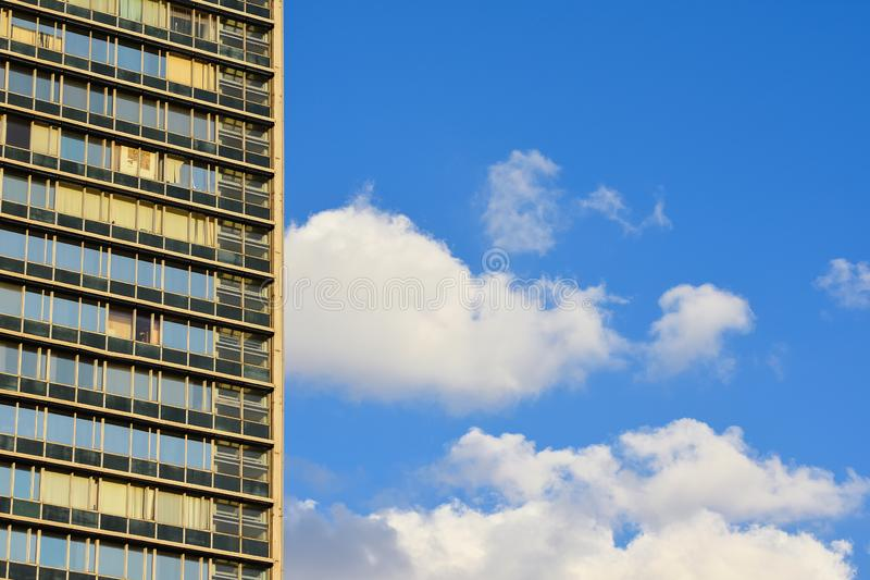 Office building against the sky. Sky and free space to the right of the multi-window building royalty free stock image