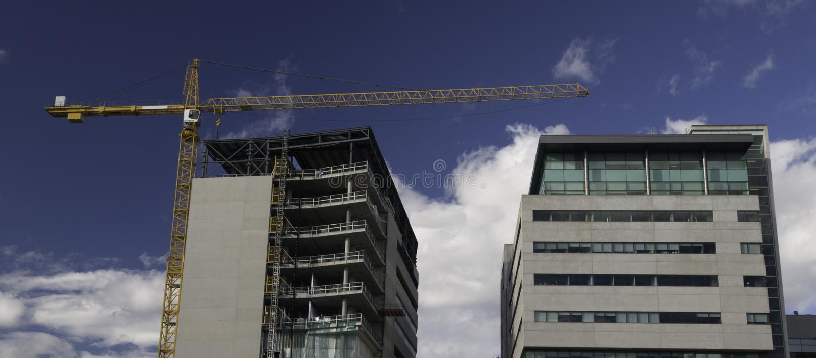 Office building construction with crane stock image