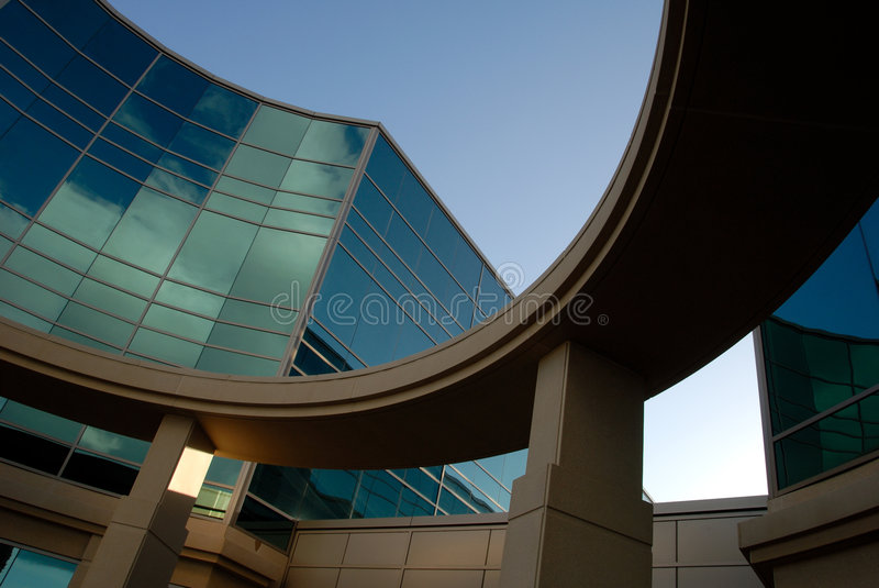 Office Building Exterior. Abstract Cloud Reflection and Curved Office Building Exterior stock photos