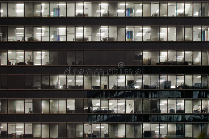 Office building illuminated at night stock photo