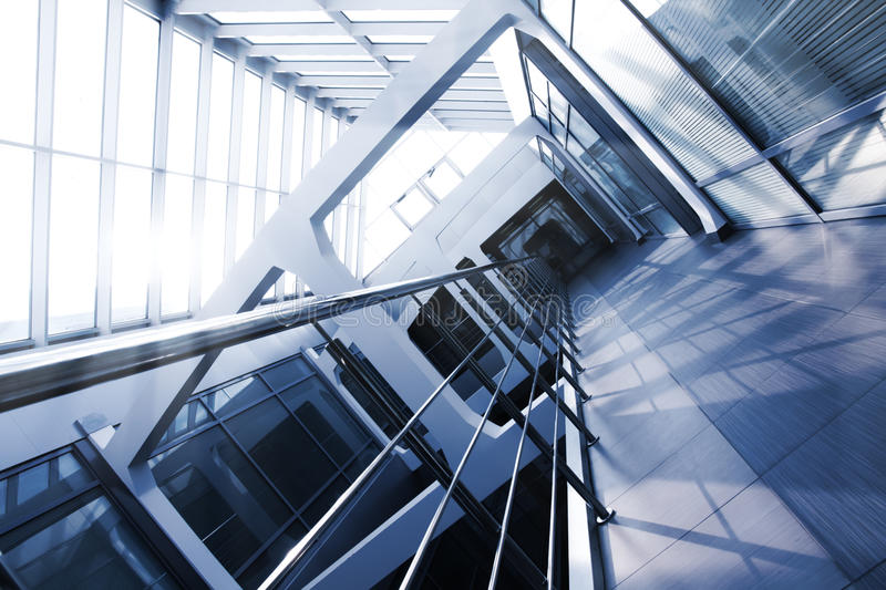 Office building interior, blue tint. Office building interior with a glass roof. Blue tint. Tilt view royalty free stock image