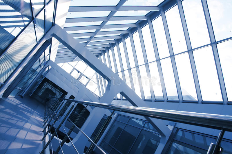 Office building interior, blue tint. Office building interior with a glass roof. Blue tint. Tilt view stock photography