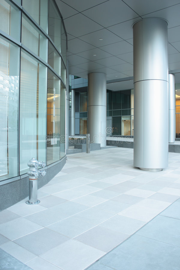 Office building lobby. With glass windows and columns royalty free stock photo