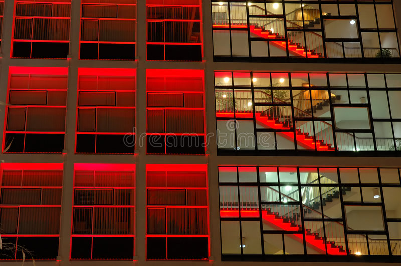 Office building in red lighting stock images