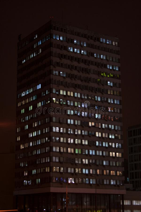 Office building silhouette with street lights reflections. In downtown on a winter night stock images