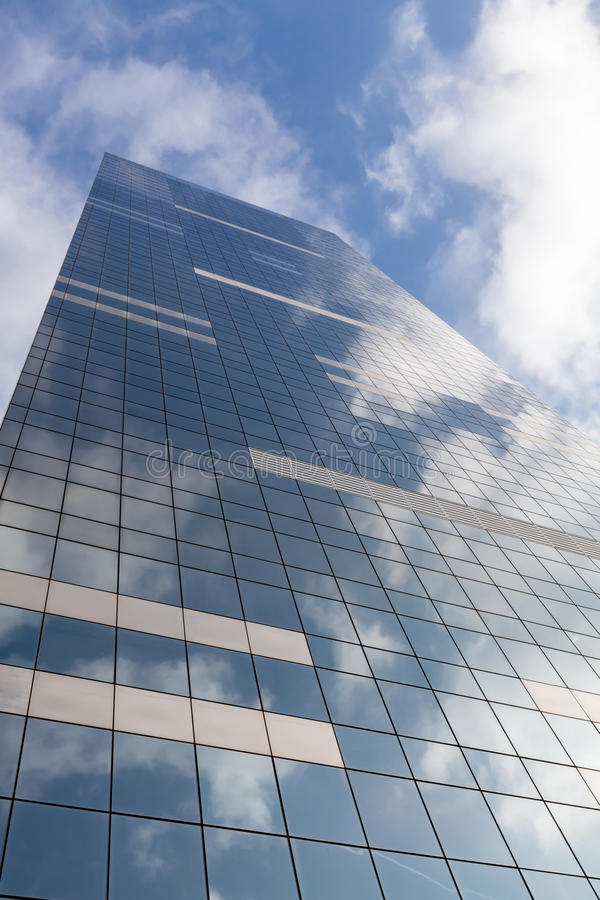 Office building on sky background with clouds reflection royalty free stock images