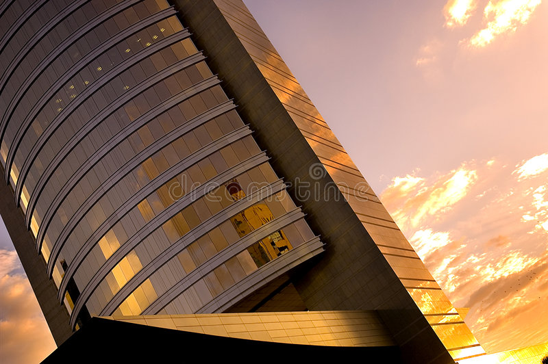 Office Building At Sunset. One of many modern towers in the City of Dubai royalty free stock images