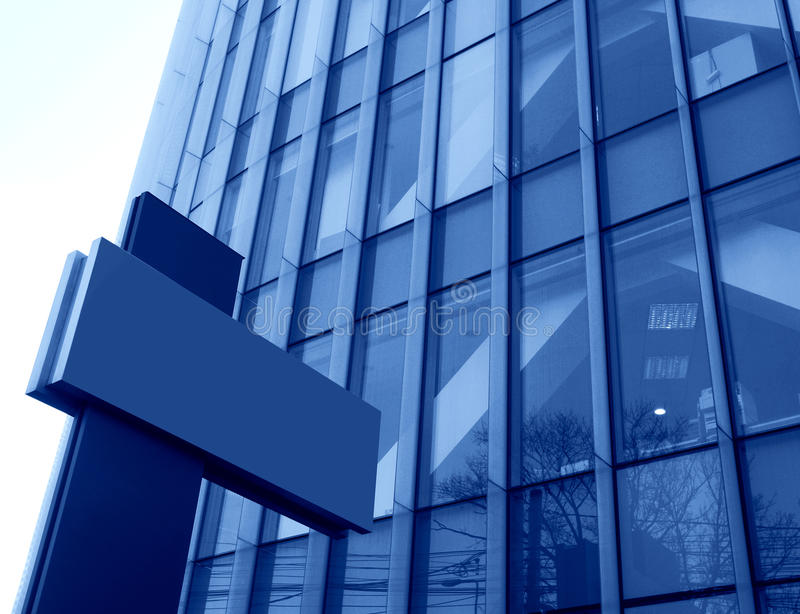 Office building toned in blue stock images