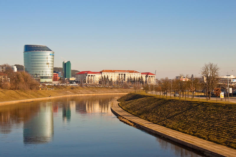 Office building and university near the river in Vilnius royalty free stock photo
