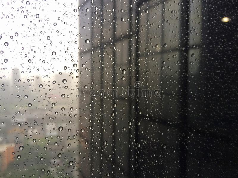 Office building windows with raindrops stock image