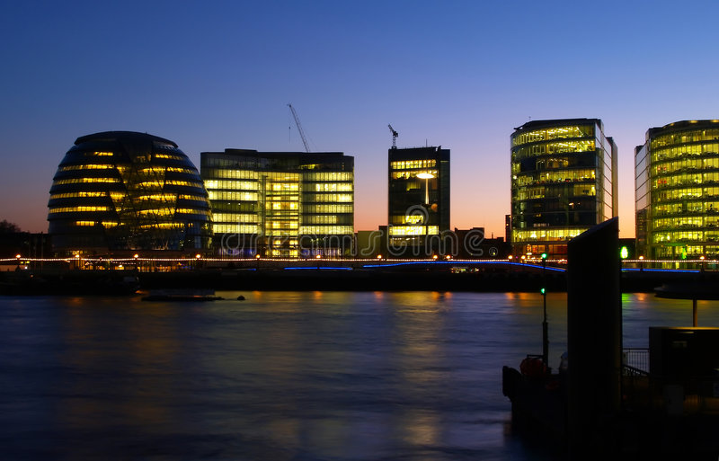 Office buildings on the bank of Thames River royalty free stock photo