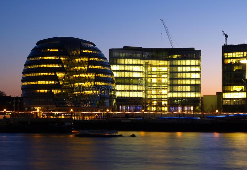 Office buildings on the bank of Thames River royalty free stock images