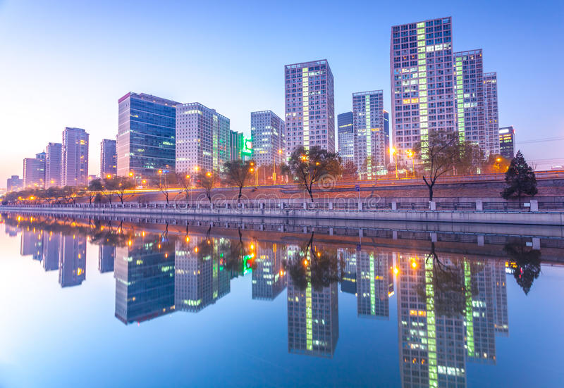 Office buildings in downtown Beijing at sunset tim stock photos