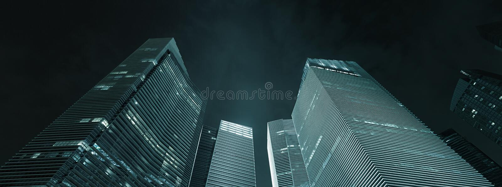 Office buildings exterior at night - modern business architecture. Office buildings exterior at night. Modern skyscrapers a sample of business architecture stock photography