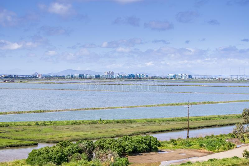 Office buildings on the shoreline of San Francisco bay as seen from Bedwell Bayfront Park, Redwood City, Silicon Valley, stock photography