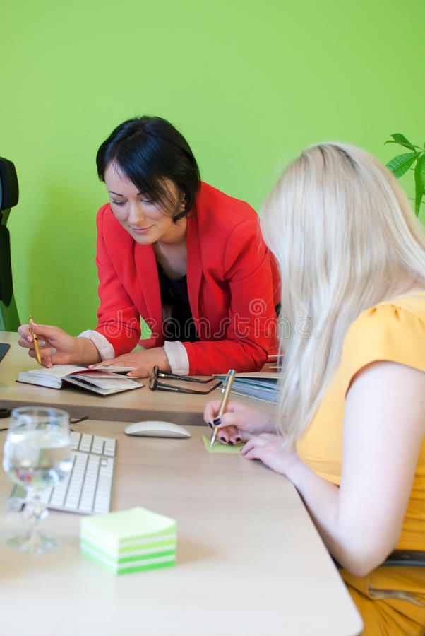 Office business dialogue woman two write work royalty free stock image