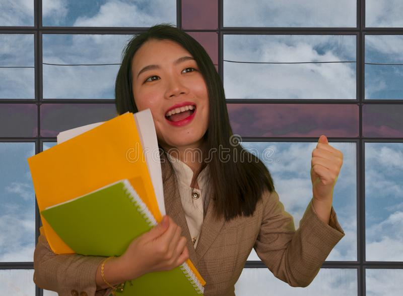 Office and business lifestyle - portrait of young happy and excited Asian Korean woman at work celebrating project success smiling royalty free stock images