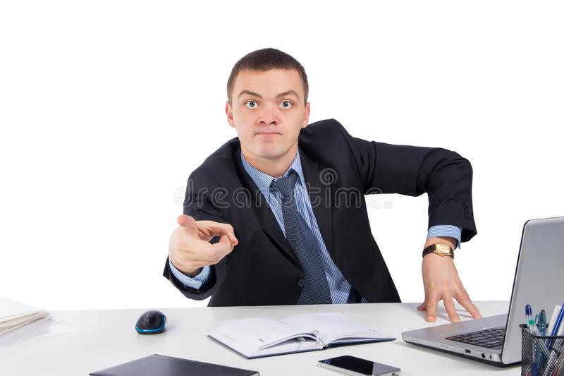 Angry businessman pointing front royalty free stock image
