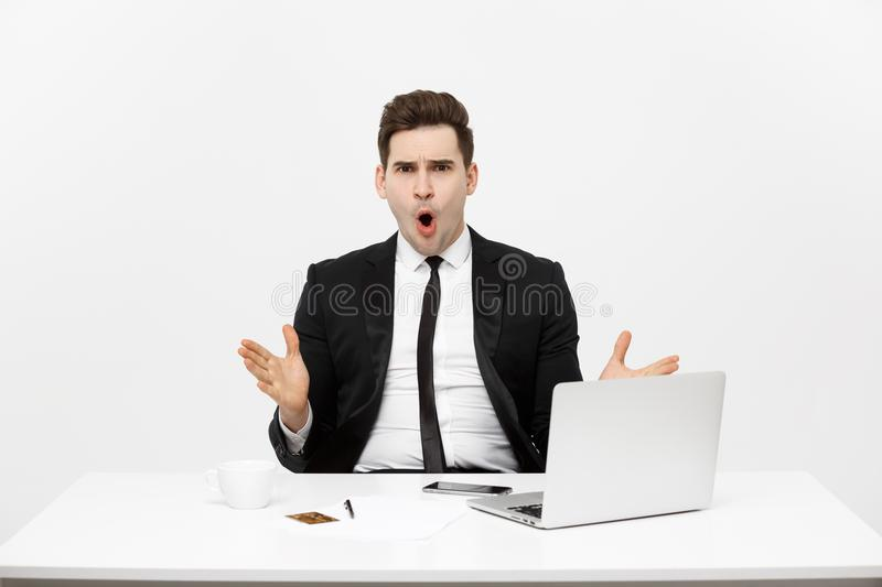 Office, business, technology, finances and internet concept - smiling businessman with laptop computer and documents at. Office isolated over white background royalty free stock photo
