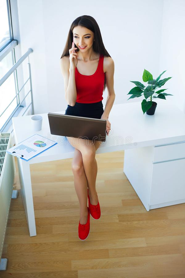 Office Business Woman Sitting Tables and Works on the Computer. royalty free stock image