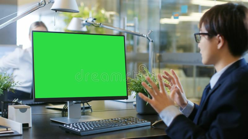 In the Office Businessman Makes Video Call on Personal Computer stock images