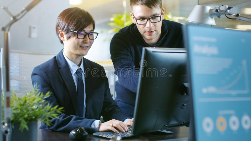 In the Office Businessman Sits at His Desk Has Discussion with H royalty free stock photography