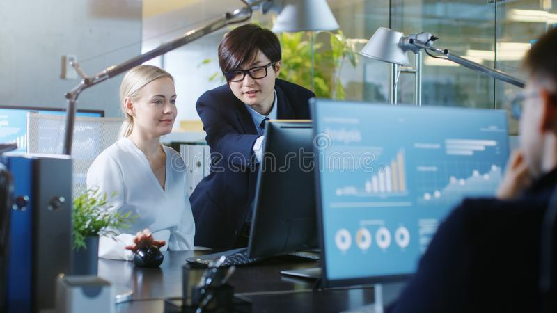 In the Office Businesswoman Sitting at Her Desk Talks with Her royalty free stock photos