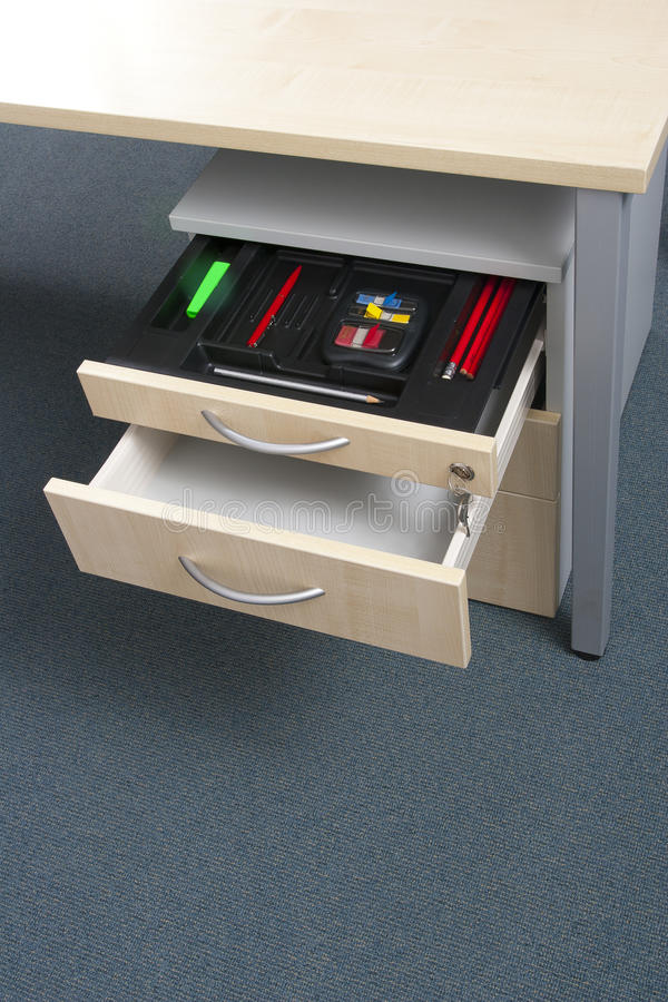 Office cabinet and drawer in light wood. Office cabinet and drawer in wood on carpet royalty free stock image