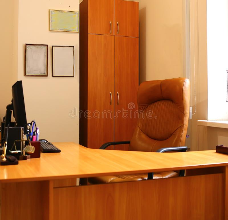 Office with chair, computer, cabinet, table, window, frame royalty free stock photography