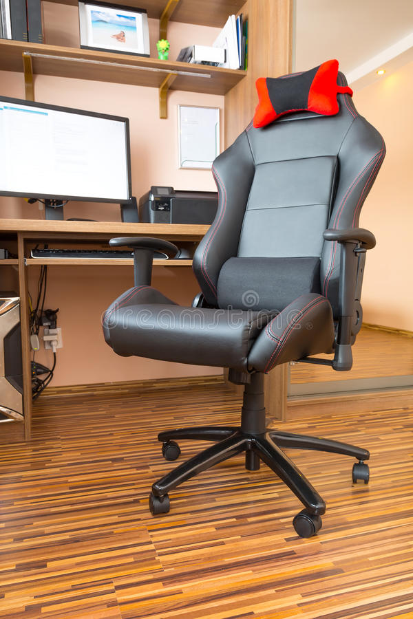 Office chair at computer desk stock images