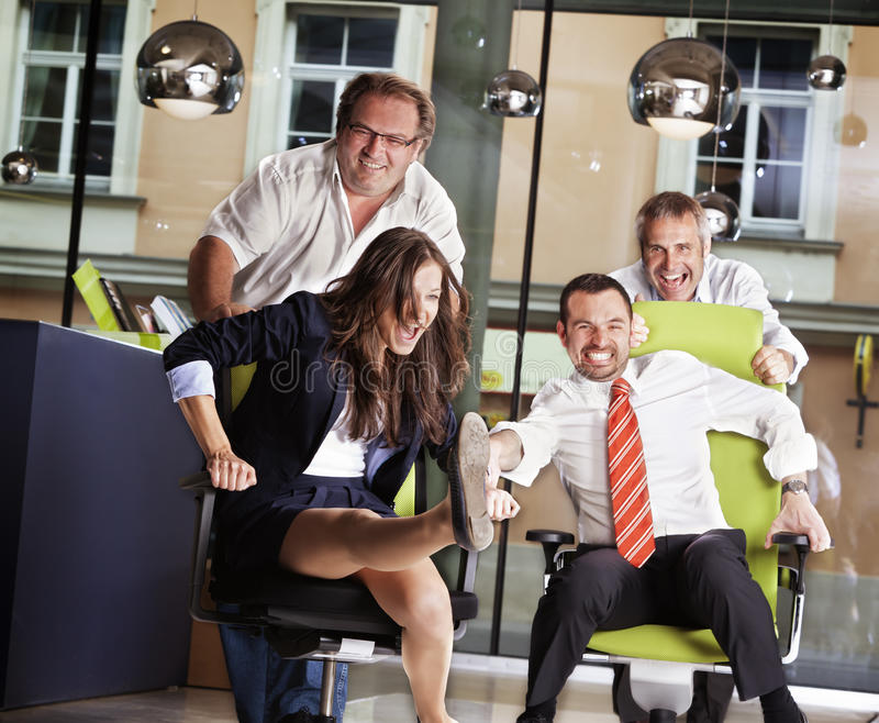 Office chair race at work. royalty free stock photography