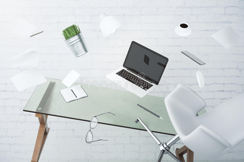 Office chaos concept with laptop, furniture and other accessories flying in the air. Close up stock photos