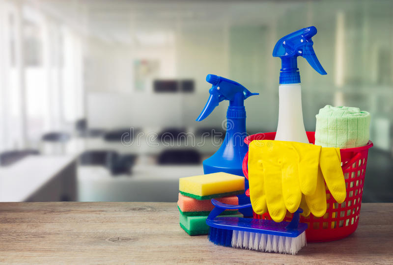 Office cleaning service concept with supplies. Over office background royalty free stock image