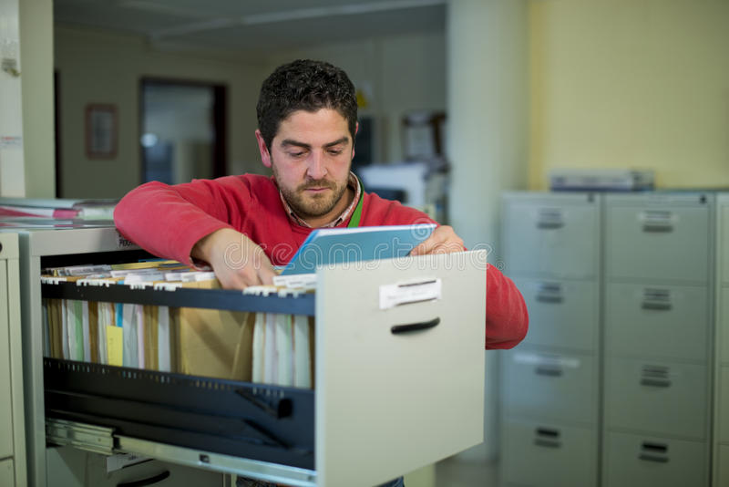 Office clerk looking some files royalty free stock photos