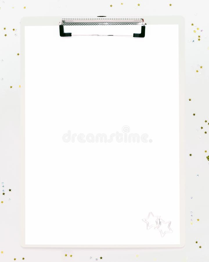 Office clipboard with copy space for creative Christmas text. On white background with confetti stock photo