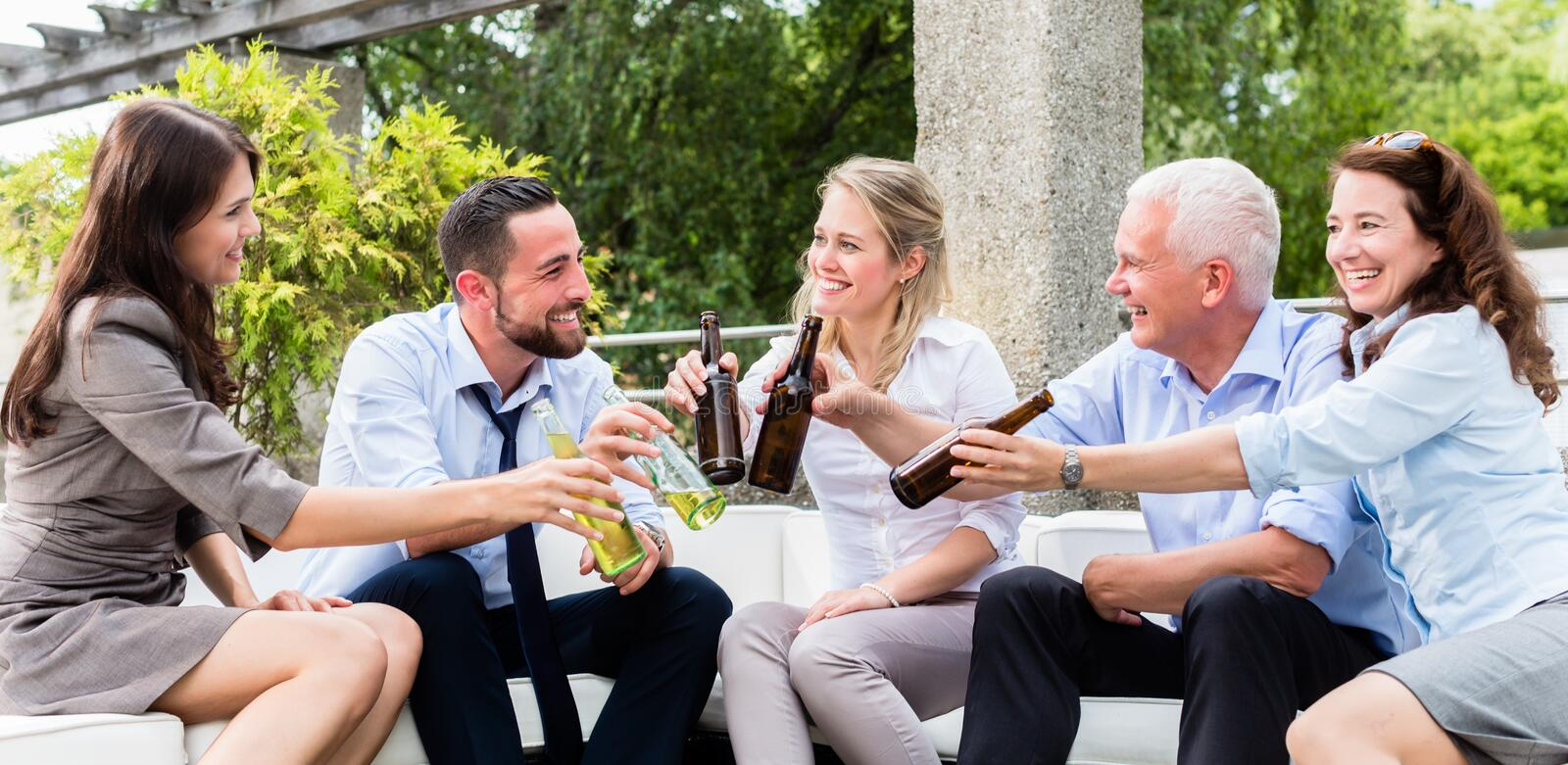 Office colleagues drinking beer after work stock photos