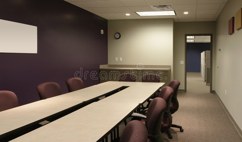 Office conference / workspace with purple wall royalty free stock images