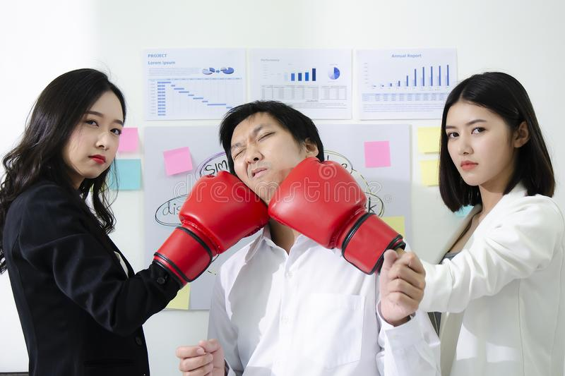 Office conflict between smart man and beautiful asian woman. Fighting in the office with team colleague stock photo