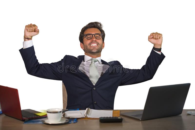 Office corporate portrait of young handsome and attractive happy businessman smiling cheerful and satisfied enjoying business succ stock photo