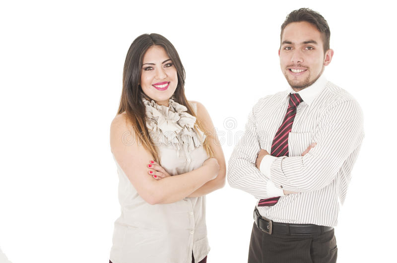 Office couple. Closeup of office couple in formal clothes stand partly opposed to each other with arms crossed royalty free stock image