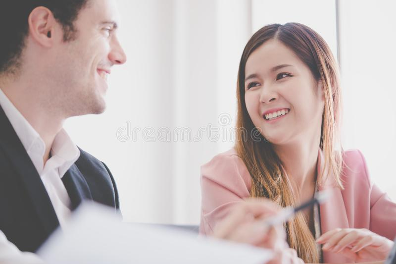 Office couple flirting, Cute Student friends is talking sw. Office lover couple flirting, Cute Student friends is talking sweet to each other royalty free stock images
