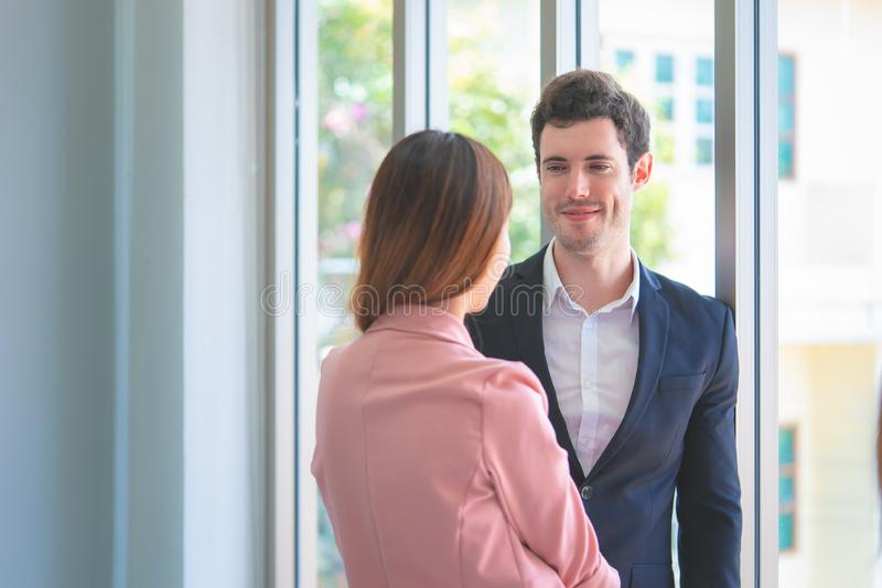 Office couple flirting, Cute Student friends is talking sweet to each other. Office lover couple flirting, Cute Student friends is talking sweet to each other royalty free stock photo